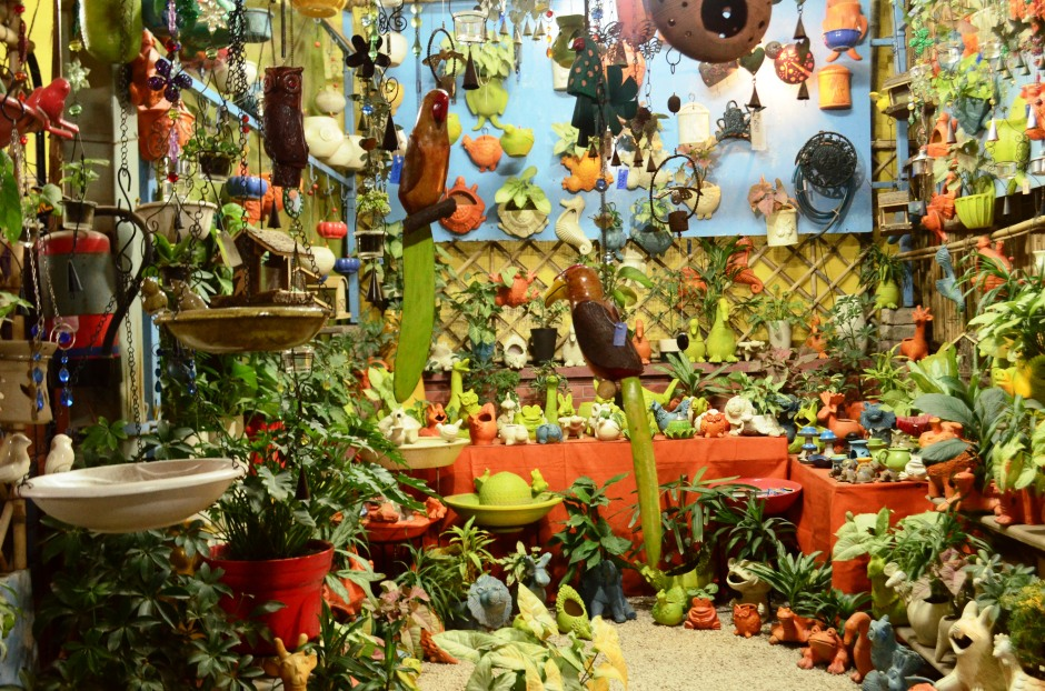 Nursery with fresh plants and colorful garden décor accessories