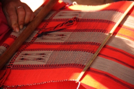 Textile being woven on backstrap loom in Nagaland
