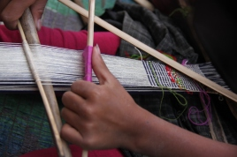 Backstrap loom weaving in process, Nagaland