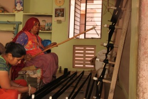 Women preparing the loom for weaving