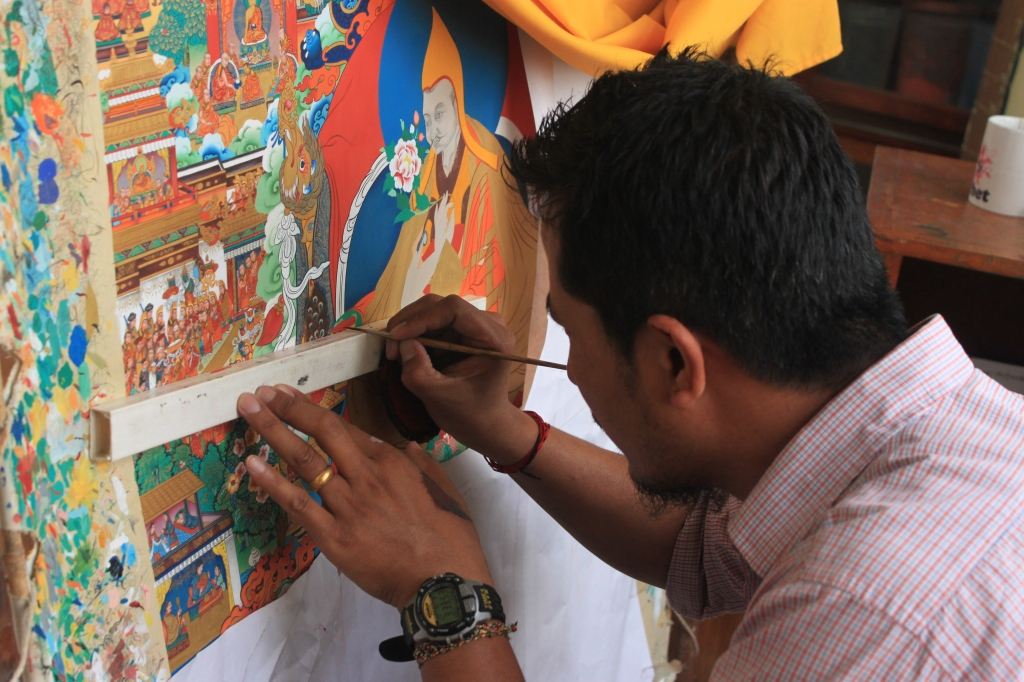 Artist Painting A Thangka